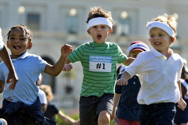 UNITED STATES - SEPTEMBER 17: Kids run a relay race during a MomsRising.org and National Womens Law Center event on the West Front of the Capitol to highlight the importance of affordable child care and early learning programs, September 17, 2015. (Photo By Tom Williams/CQ Roll Call)